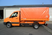 Tipper for municipal administration with covering