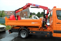 Tipper for municipal administration with crane