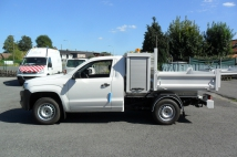 VW Amarok tipper and case behind the cabin